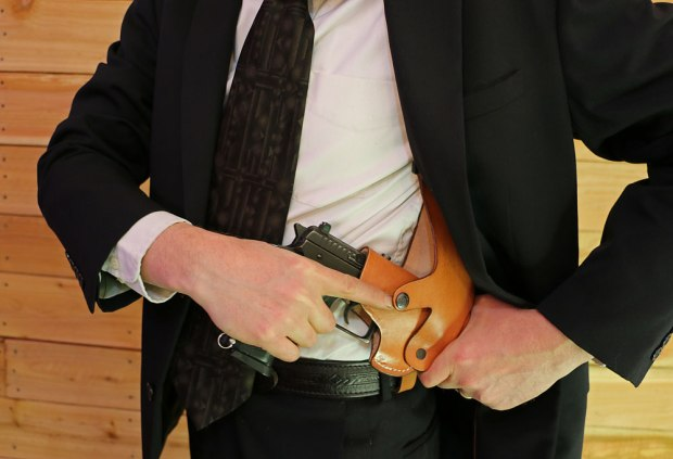 To reholster, slide the pistol into the holster . . .