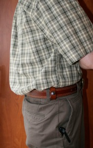 Deep Concealment holster tucked under a shirt.