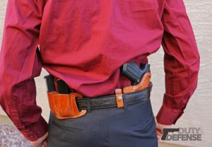 An ideal system for use when suits are worn: The very flat and concealable Deep Concealment Tuckable holster, a Holster belt, and a leather magazine pouch. Notice how tightly the pistol and magazines fit to the body.